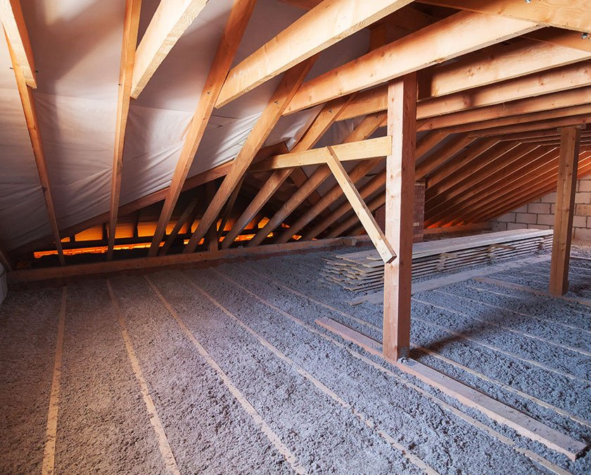 Cellulose applied on the floor of a wooden structure attic.