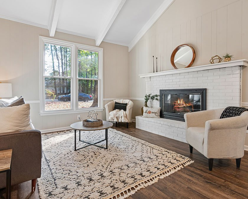 Comfortable interior of a home with large living room and fireplace